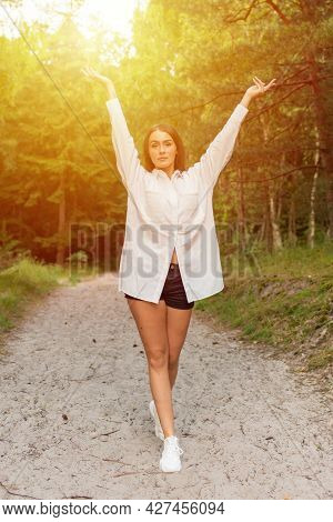 Happy Young Pretty Woman Outstretching Hands In A Summer Forest.countryside Background.front View.
