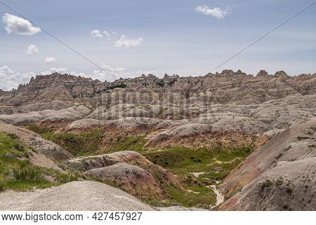 Badlands National Park, Sd, Usa - June 1, 2008: A Bad Place To Loose A Calf Is This Wirwar Of Geolog