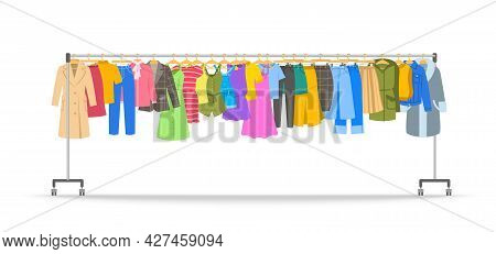 Women Clothes On Long Rolling Hanger Rack. Many Different Garments Hanging On Store Hanger Stand Wit
