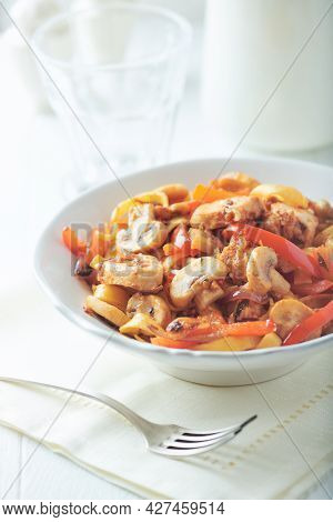 Pappardelle Pasta With Chicken Breast, Red Pepper And Champignons. Bright Background. Close Up.