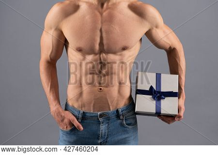 Sexy Man With Muscular Torso Cropped View Hold Present Box. Fitness Gift. Birthday Present