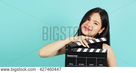 Clapper Board Or Movie Clapperboard In Teenage Girl Or Woman Hand.it Use In Video Production ,film,