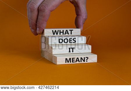 What Does It Mean Symbol. Concept Words 'what Does It Mean' On Wooden Blocks. Beautiful Orange Backg