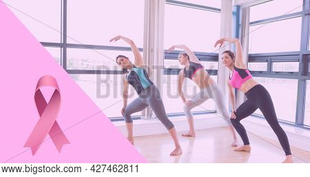 Composition of pink ribbon logo and breast cancer text, with diverse group of women practicing yoga. breast cancer positive awareness campaign concept digitally generated image.