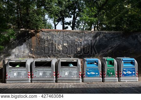 Separate Trash Bins For Unsorted Waste And Recycled Types Of Garbage. Concept Of Green Economics And
