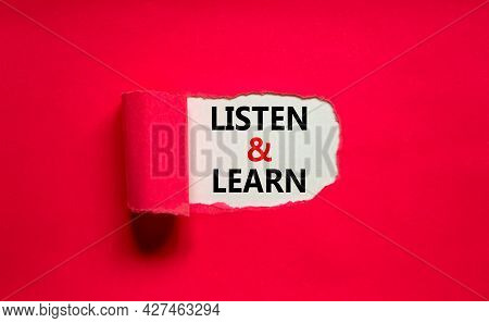 Listen And Learn Symbol. Words 'listen And Learn' Appearing Behind Torn Purple Paper. Beautiful Purp