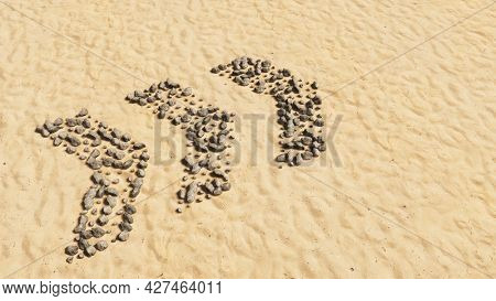 Concept or conceptual stones on beach sand handmade symbol shape, golden sandy background, dangerous turn road sign. 3d illustration metaphor for caution, warning, safety and guidance