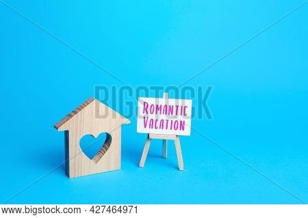 House With A Heart And An Romantic Vacation Easel. Choosing A Place For A Trip. Affordable Cheap Hou