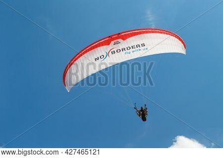 Myrtos Beach, Cephalonia Island, Greece - July, 13 2019: Tandem Paragliding Against A Blue Sky On Th