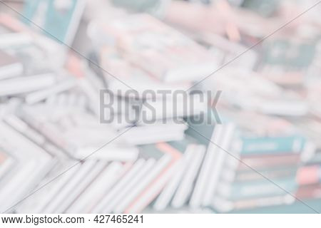 Pile Of Books In Bookstore Or In Library, Abstract Background . Education, School, Study, Reading Fi