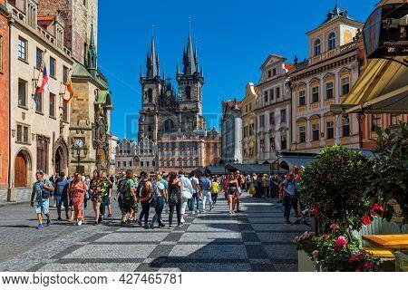 PRAGUE, CZECH REPUBLIC - SEPTEMBER 04, 2019: People on Old Town Square (aka Staromestske Namesti) as Tyn church on background in historic part of Prague - capital city and popular tourist destination.