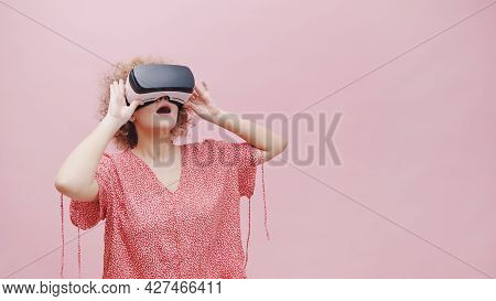 Girl Wearing Virtual Reality Goggles Vr Box Watching A 3d Movie. Feeling Amazed. The Girl Is Lost In