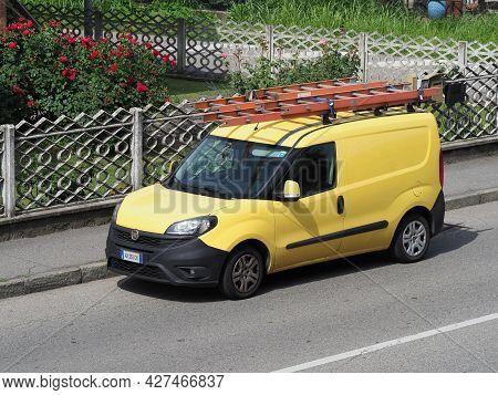 Milan, Italy - Circa July 2021: Yellow Fiat Doblo Cargo Van