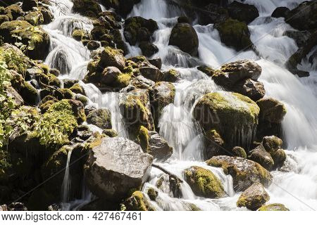 Landscape Showing Some Big Rocks And Water Flowing In A Big Waterfall Called Uelhs Deth Joeu In Cata