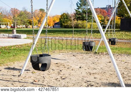 Swing At Playground In Public Park In Autumn Without People