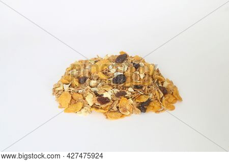 Healthy Muesli With Oat Flakes, Nuts And Raisins Isolated On White Background.