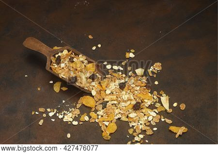 Healthy Cereal Breakfast. Mixed Muesli In Wooden Scoop Isolated On Wooden Background.