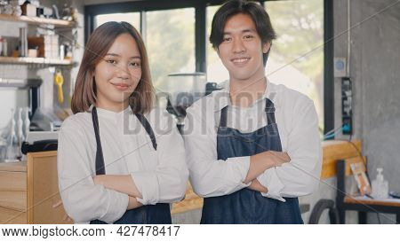 Portrait Of Happy Handsome Young Man And Beautiful Woman Confident Cafe Owner Standing Crossed Arms