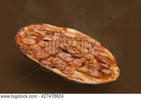 Sweet Brazilian Pizza With Banana, Cinnamon And Sugar, Side View