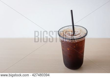 Iced Americano Black Coffee Cup On The Table In A Coffee Shop