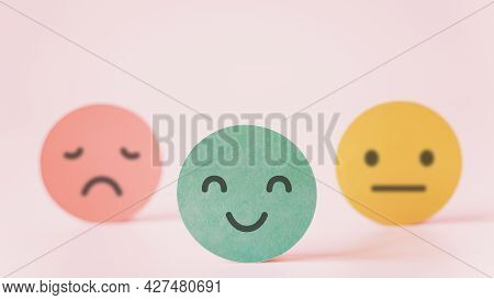 Outstanding Smiling Face On Green Paper With Speech Bubble On Pink Background, Satisfaction Survey ,