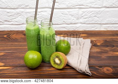 Detox And Diet Food For Breakfast. Fresh Green Smoothie On Rustic Wooden Background. Glasses With Gr
