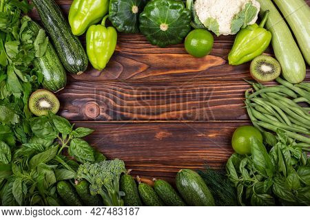 Top View Of Healthy Food Clean Food: Frame Of Vegetables, Superfoods, Leafy Vegetables On Wooden Bac