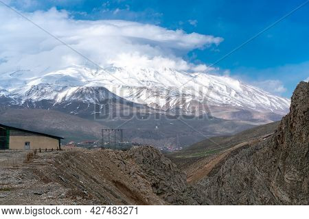 Clouds Gather Near The Summit Of Mt. Damavand, The Highest Stratovolcano In Asia. Partly Cloudy Afte