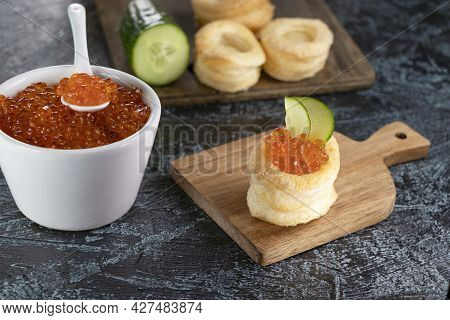Recipe For Appetizer With Red Caviar. Tartlets, Cucumber And Red Caviar. Top View. Soft Focus