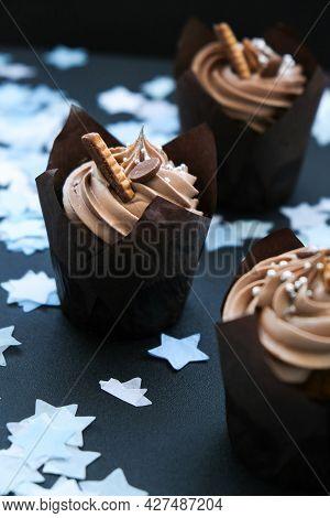 Delicious Chocolate Cupcakes With Cream On Dark Background. Three Chocolate Muffin. Birthday Cake Pa