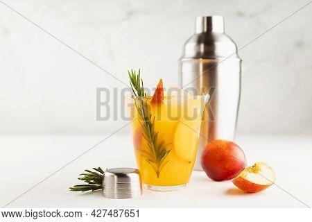 Recipe Of Cooking Healthy Summer Peach Juice - Cocktail With Ice, Rosemary Twig, Sugar Rim In Glass,