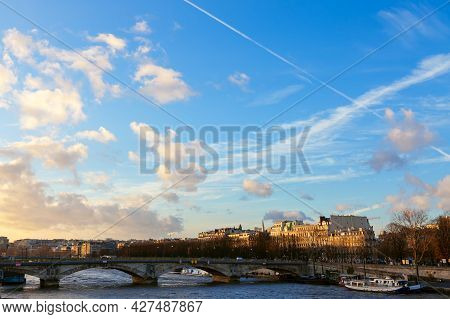 Pont Des Invalides Bridge Traversing The Seine In Paris . France Capital City In The Evening
