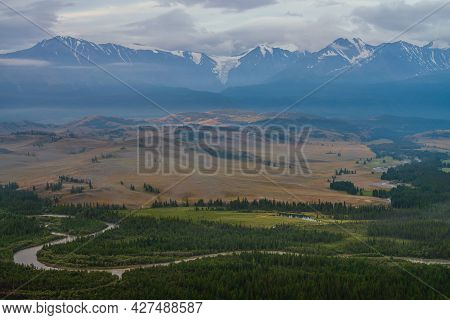 Vintage Landscape With Vast Plateau With Mountain River And Forest On Background Of Snowy Mountain R