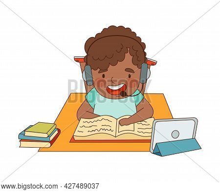 Home Study And Distance Learning With African American Boy In Front Of Tablet Pc Training And Doing