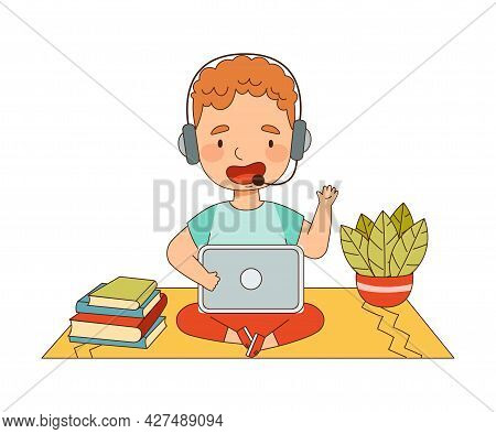 Home Study And Distance Learning With Redhead Boy With Headphones In Front Of Tablet Pc Training And