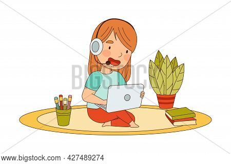 Home Study And Distance Learning With Redhead Girl With Headphones In Front Of Tablet Pc Training An