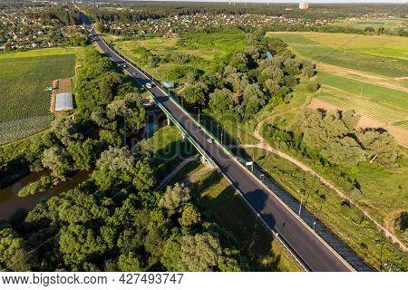 Aerial View Of Varshavskoe A-130 Highway Crossing The Protva River, Beautiful Landscape. Obolenskoye