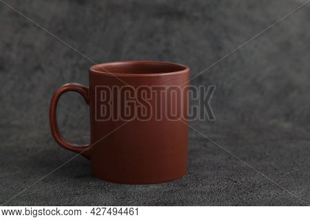 Empty Brown Ceramic Mug. Rustic Cup On Dark Grey Background. Copy Space. Rustic Dishes