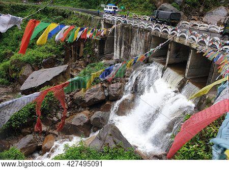 Phuentsholing, Bhutan - May 04, 2019: A Beautiful Fall Of A Himalayan River In Bhutan Below A Bridge