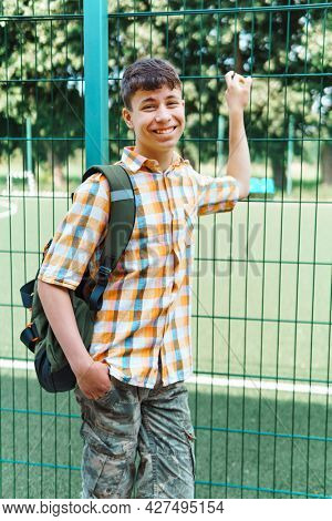 teen boy portrait on the way to school, education and back to school concept