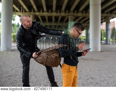 The Thug Breaks The Bottle On The Mans Head And Steals The Backpack. Attack With The Purpose Of Thef
