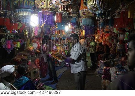 Pune, India - October 27, 2013: A Shopkeeper And His Family Arranging Traditional Lanterns In Their