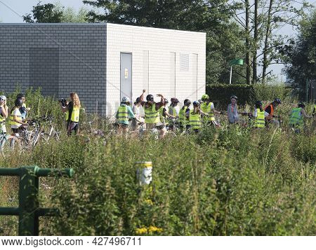 Sint Gillis Waas, Belgium, July 11, 2021, Group Of Local Scouts Wearing Yellow Fluorescent Vests Get