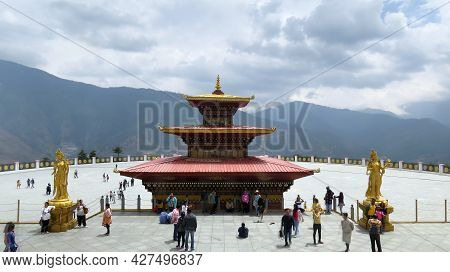 Thimpu, Bhutan - April 30, 2019: A View Of Tourists At A Tourist Place In Bhutan With The Great Hima