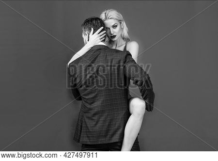 Passion And Desire. Unshaven Guy Embrace Attractive Lady. Sensual Relationship. Girl With Her Lover.