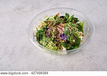 Salad With Smoked Duck Breast, Vegetables, Cheese And Herbs In A Transparent Container. Designer Foo