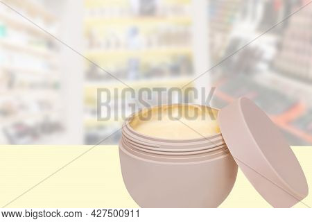 Closeup Of An Open Cosmetic Jar Of Concealer Cream, Makeup Foundation, Moisturising Cream For The Fa