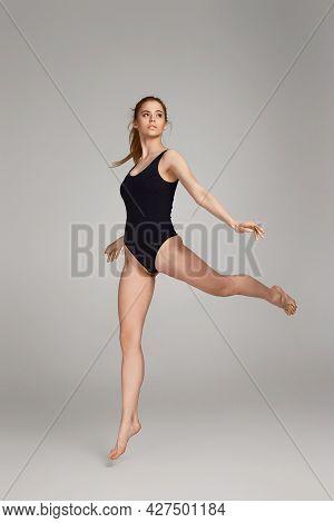 Beautiful Slim Woman With Perfect Body In Black Bodysuit