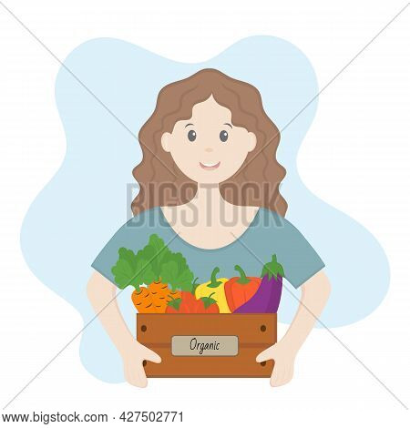 The Girl Holds A Box Of Organic Vegetables In Her Hands. Organic Farming Concept, Local Farmers Mark