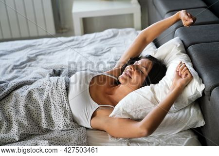 Happy Woman Waking Up After Good Sleeping In Bedroom